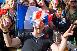 © Licensed to London News Pictures. 10/07/2016. London, UK. Fans gather to watch the UEFA Euro 2016 Final at the big screen at Pop Football Kennington, run by Six Yard Box, where Euro 2016 hosts France play Portugal. Photo credit : Tom Nicholson/LNP