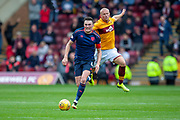 John Souttar (#4) of Heart of Midlothian runs past Curtis Main (#9) of Motherwell FC during the Ladbrokes Scottish Premiership match between Motherwell and Heart of Midlothian at Fir Park, Motherwell, Scotland on 15 September 2018.