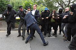 © Licensed to London News Pictures. 15/07/2016. LONDON, UK. Scuffles and a fight breaks out between a Boris supporter, Class War and police. Demonstrators from Class War stage a protest outside Foreign Secretary, Boris Johnson's house in north London against Boris Johnson's appointment as Foreign secretary, claiming he is racist.  Scuffles broke out between a passer by who supported Boris Johnson, protesters and police. Photo credit: Vickie Flores/LNP