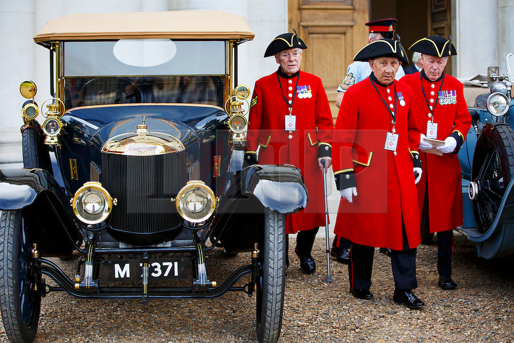 © Licensed to London News Pictures. 04/08/2014. LONDON, UK. Chelsea pensioners at Royal Hospital Chelsea getting ready to take part in The Great War Centenary Parade, a procession of over 40 Edwardian cars, all of which would have been on the road during the Great War. The procession marks the 100th year since Great Britain declared war on Germany in WW1. Photo credit : Tolga Akmen/LNP