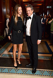 Anna Elisabet Eberstein and Hugh Grant attending the afterparty for The Irishman as part of the BFI London Film Festival 2019 held at Freemasons Hall in London.