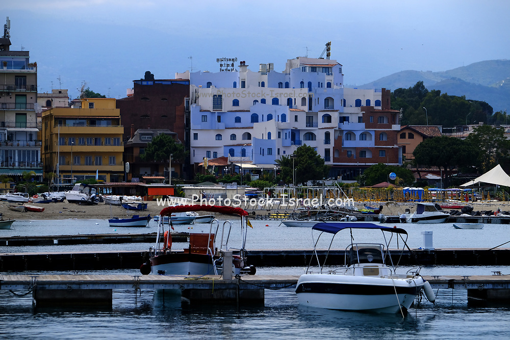 Yachts and boats in the resort of Giardini Naxos bay, Taormina, Sicily, Italy