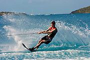 British Virgin Islands, Caribbean.  Man slalom water skiing in blue ocean water of the North Sound.