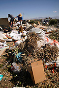 About 50% of the residential refuse deposited for disposal at the City of Tucson's Los Reales Landfill could be recycled, according to spokesperson, Cristina Polsgrove.  This includes common items, such as plastic bags and cardboard, which are placed in the curbside trash cans, rather than in the curbside recycling cans.  Other potentially recyclable materials are deposited directly at the landfill by residential haulers.  The landfill receives about 500,000 tons of refuse annually.  The site, located in Tucson, Arizona, USA, is designated as a superfund site by the Arizona Department of Environmental Quality.