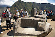 Guide with group at Intihuatana, Machu Picchu  Peru  Not Released