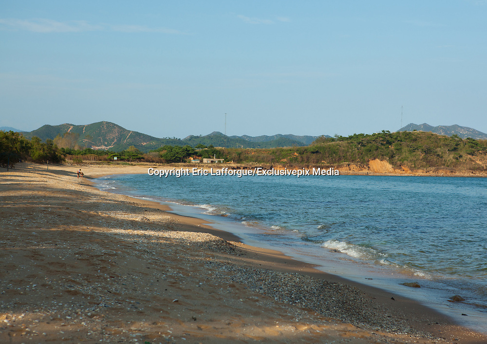 EXCLUSIVE<br /> A Chemical Beach Tour in North Korea<br /> <br /> For a long time, I had wanted to enjoy the beaches of North Korea promoted in official brochures. But the best one &ndash; located on the East Coast in Hamhung, the second largest city in the DPRK with a population of 800,000 &ndash; was not open to tourists. This finally changed in 2011 and I jumped on the opportunity to be one of the first to visit the place.<br /> <br /> My North Korean guide got starry-eyed while talking about this beach. He was extolling the &quot;excellent stretches of pristine beach.&rdquo; I don&rsquo;t think that he ever went there but he learnt the official propaganda by heart.<br /> He told me that every North Korean citizen had the secret dream of enjoying a beach holiday. On the brochure he gave me, it said, &ldquo;Majon, the resort in the suburbs of Hamhung and an industrial city&rdquo; &ndash;&nbsp;an example of North Korean marketing.<br /> <br /> After arriving in Hamhung, a five-hour drive from Pyongyang, I follow the mandatory city tour. One stop in front of the Grand Theatre &ndash; not possible to go inside. I&rsquo;m allowed to open the bus window if I want to take a picture. Another stop in front of Kim Il Sung&rsquo;s giant statue. My guide explains, &ldquo;The hill was built by people so they could erect the statue of the Great Leader Kim Il Sung on top of it. From there, you have a great view over the city. Let&rsquo;s go!&rdquo;<br /> In fact, the view from the top shows a dull city surrounded by the smoke from the factory chimneys as Hamhung is home to the best beach in North Korea but is also an industrial city with many chemical complexes. Everywhere we drive, we see factories when they are not hidden by the chimney smoke.<br /> <br /> My guide tells me that there is no pollution in the city&hellip; I ask him to be serious for once. Perhaps the air is pure in Pyongyang, but in Hamhung, it&rsquo;s another story. But he keeps repeating that the air is pure.