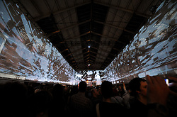 © Licensed to London News Pictures. 17/08/2012. Bristol, UK.  Projections at a performance of Mail, Maps and Motion by Adrian Utley (Portishead), Joanie Lemercier and guest performers including mass electric guitars at the Passenger Shed, Temple Meads station, Bristol as part of the See No Evil event.  Artists from around the world created new work on buildings in Nelson Street, Bristol.  It will be the biggest permanent street art installation in Europe.  The project runs till 19 August, with a Block Party on 18 August. 17 August 2012..Photo credit: Simon Chapman/LNP