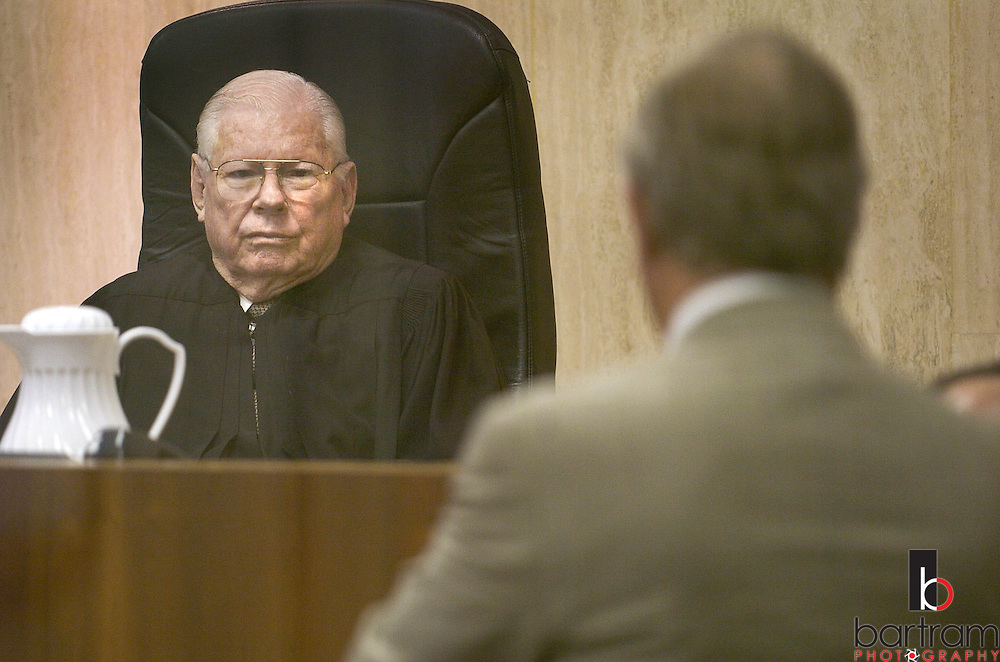 Judge Jackson Smith listens as Dick DeGuerin, an attorney for Robert Durst, questions a witness during a hearing to remove Judge Susan Criss from the Durst case on Wednesday, Sept. 29, 2004 in Galveston, Texas. Jackson ruled that Judge Criss should be removed from future proceedings involving the New York real estate heir.