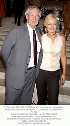 TV Film critic MR BARRY NORMAN with his daughter tv presenter SAMANTHA NORMAN, at a party in London on 15th April 2003. PIX 120