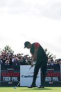 Nov 23, 2018; Las Vegas, NV, USA; Tiger Woods plays his shot from the first tee during The Match: Tiger vs Phil golf match at Shadow Creek Golf Course.
