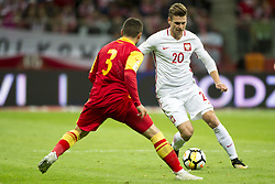 October 8, 2017 - Warsaw, Poland - Lukasz Piszczek of Poland and Vladimir Jovovic of Montenegro during the FIFA World Cup 2018 Qualifying Round Group E match between Poland and Montenegro at National Stadium in Warsaw, Poland on October 8, 2017  (Credit Image: © Andrew Surma/NurPhoto via ZUMA Press)