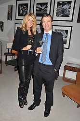A reception in honour of David Linley to recognise his ambassadorial role for Ruinart Champagne held at Linley, Pimlico Road, London on 24th October 2012.<br /> Picture shows:-ROLAND & COLETTE FOX.