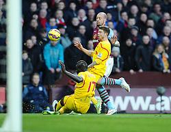 Liverpool's Mamadou Sakho tackles Aston Villa's Alan Hutton  - Photo mandatory by-line: Joe Meredith/JMP - Mobile: 07966 386802 - 17/01/2015 - SPORT - Football - Birmingham - Villa Park - Aston Villa v Liverpool - Barclays Premier League