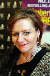 """© Licensed to London News Pictures. 20/02/2016<br /> Kimberley Chambers,  her new book """" Tainted Love"""".<br /> Crime ficton author Kimberley Chambers at Waterstones book store Bluewater,Greenhithe,Kent.<br />  (Byline:Grant FalveyLNP)"""