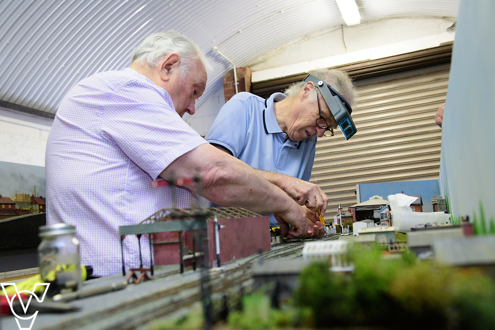 INSIGHT MAGAZINE: Bridlington Model Railway Society are based in Station Road, Bridlington, in a railway arch unit owned by Network Rail.  Pictured is Harold Bellhouse, left, and Neil Porter working on the model of Filey Station.<br /> <br /> Picture: Chris Vaughan Photography<br /> Date: May 31, 2017