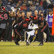 10 September 2016: The San Diego State Aztecs football team hosts Cal in their second game of the season.  San Diego State cornerback Derek Babiash (31) and linebacker Randy Ricks (40) combine for a tackle in the fourth quarter. The Aztecs beat Cal 45-40 to keep their win streak at 12 games going back to last season and improve their record to 2-0.