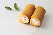 Cheese stuffed cannelloni on white background