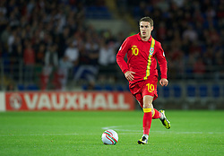CARDIFF, WALES - Friday, October 12, 2012: Wales' Aaron Ramsey in action against Scotland during the Brazil 2014 FIFA World Cup Qualifying Group A match at the Cardiff City Stadium. (Pic by David Rawcliffe/Propaganda)