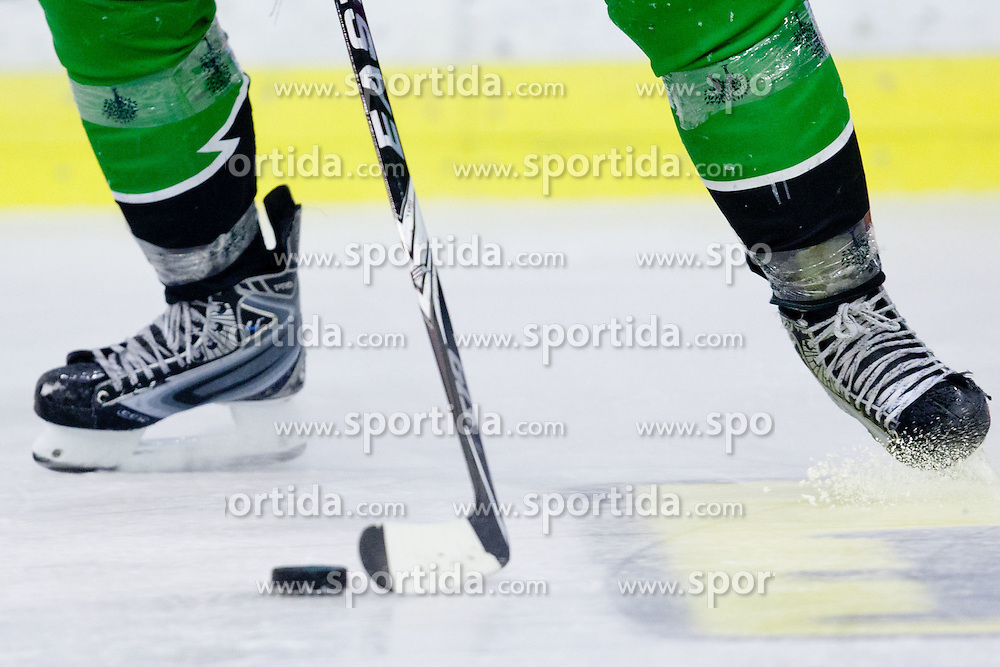Puck, stick and skates during ice-hockey match between HDD Tilia Olimpija and SAPA Fehervar AV19 at second match in Quarterfinal  of EBEL league, on Februar 21, 2012 at Hala Tivoli, Ljubljana, Slovenia. HDD Tilia Olimpija won 2:1 in OT. (Photo By Matic Klansek Velej / Sportida)
