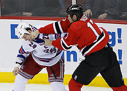 Feb 9, 2009; Newark, NJ, USA; New Jersey Devils left wing Mike Rupp (17) and New York Rangers right wing Colton Orr (28) during the second period at the Prudential Center.