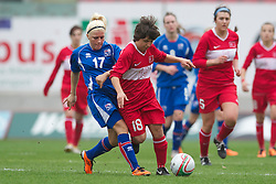 LLANELLI, WALES - Thursday, March 31, 2011: Iceland's captain Arna Sif Asgrimsdottir and Turkey's Fatos Yildirim during the UEFA European Women's Under-19 Championship Second Qualifying Round (Group 3) match at Parc Y Scarlets. (Photo by David Rawcliffe/Propaganda)