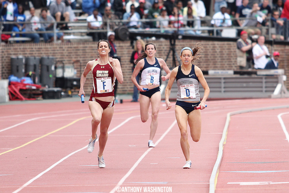 Caroline King (left) of Boston College edges Emily Infeld of Georgetown by .46 of a second to win the College Women's 4x1500 Championship of America at the Penn Relays athletic meet on Friday, April 29, 2011 in Philadelphia, PA.