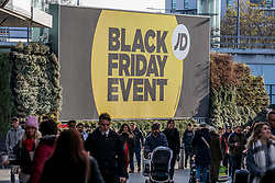 © Licensed to London News Pictures. 29/11/2019. London, UK. Shoppers walk up to Westfield in West London for Black Friday, as thousands of stores across the country are slashing prices to entice shoppers.Photo credit: Alex Lentati/LNP