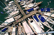 Yachts stern to a marina dock, Falmouth harbour, Antigua.