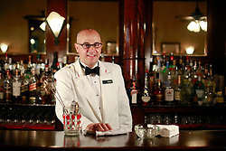 03 Sept 2014. New Orleans, Louisiana. <br /> Chris Hannah, bar manager at Arnaud's French 75 Bar in the French Quarter.<br /> Photo; Charlie Varley/varleypix.com