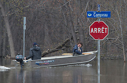 A woman rests her head on her hand as she travels through a flooded residential area of Gatineau, Quebec, Canada., Monday, May 8, 2017. Photo by Adrian Wyld /The Canadian Press/ABACAPRESS.COM