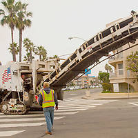 George Ridcumb from All American Asphalt drives an Asphalt Milling Machine down  Ocean Avenue in Santa Monica on Wednesday, November 30, 2011.