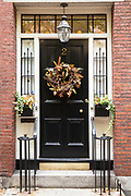 Elegant black front door of a home in the Beacon Hill historic district of the city of Boston, Massachusetts, USA