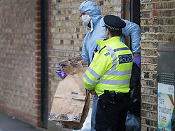 FILE PICTURE © Licensed to London News Pictures. 21/09/2017. London, UK. A police forensics officer carries an evidence bag from a house belonging to Sabrina Kouider and her partner Ouissem Medouni where police and the fire brigade attended and found the burnt body of their nanny Sophie Lionnet in the garden in Wimbledon, south London. Kouider and Medouni, who are both French nationals, deny murder but have admitted perverting the course of justice by burning the body. Photo credit: Peter Macdiarmid/LNP
