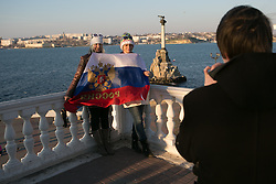 Pro russian crimean's posing with a Russian Federation flag  in the waterfront of Sevastopol three days before the referendum. Ukraine , Thursday, 13th March 2014. Picture by Daniel Leal-Olivas / i-Images