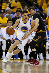 The Golden State Warriors' Klay Thompson (11) drives around the Cleveland Cavaliers' Kyle Korver (26) in the second quarter of Game 5 of the NBA Finals at Oracle Arena in Oakland, Calif., on Monday, June 12, 2017. (Photo by Nhat V. Meyer/Bay Area News Group/TNS) *** Please Use Credit from Credit Field ***
