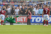 Northampton Town goalkeeper Luke Coddington (30)  dives the wrong way as Peterborough United midfielder Marcus Maddison (11) scores from the penalty spot (1-4) during the EFL Sky Bet League 1 match between Northampton Town and Peterborough United at Sixfields Stadium, Northampton, England on 26 August 2017. Photo by Dennis Goodwin.