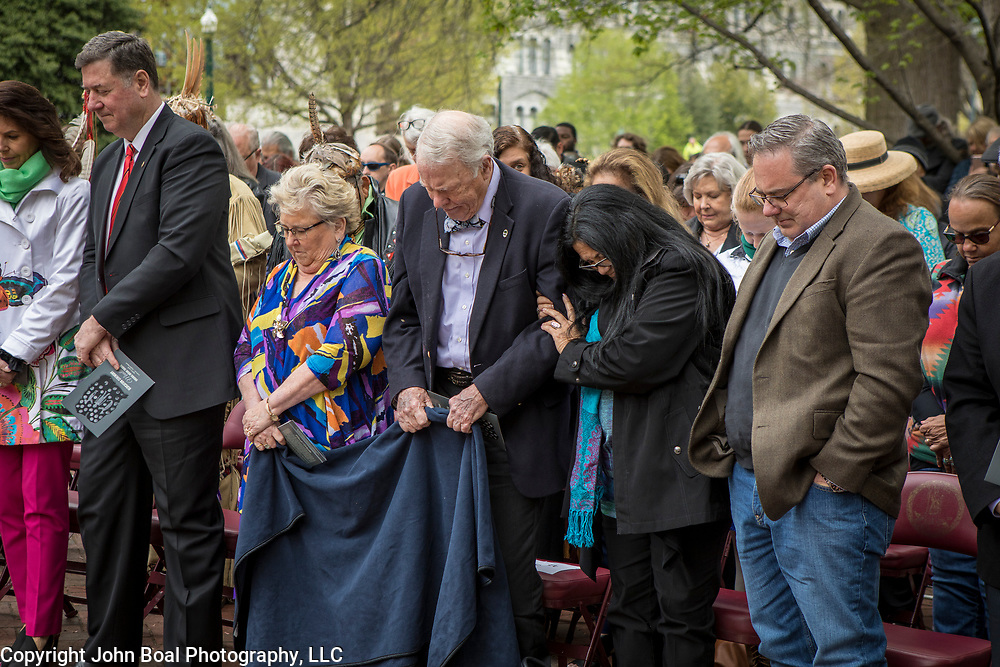 Attendees stand as Ken Adams, Chief of the Upper Mattaponi, gives a blessing during the dedication ceremony for Mantle: Virginia Indian Tribute, a monument designed on Virginia State Capitol Square, in Richmond, Virginia, on Tuesday, April 17, 2018. Michelson, a New York based artist, designed the monument in Capitol Square next to the Bell Tower along North Ninth Street. John Boal Photography