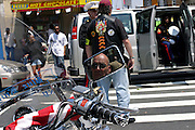 Member of the Patriot Guard Riders seen through the rear mirror of his motorbike in front of the Bedsford Central Presbyterian church, while awaiting the passage of LCpl. Nicholas J. Whyteís coffin, in Brooklyn, New York, NY., on Friday, June 30, 2006. LCpl. Nicholas J. Whyte, a 21-year-old American serviceman died  on June 21, 2006, while conducting combat operations in Al Anbar province, Iraq. The Patriot Guard Riders is a diverse amalgamation of riders from across the United States of America. Besides a passion for motorcycling, they all have in common an unwavering respect for those who risk their lives for the country's freedom and security. They are an American patriotic group, mainly but not only, composed by veterans from all over the United States. They work in unison, calling upon tens of different motorcycle groups, connected by an internet-based web where each of them can find out where and when a 'Mission' is called upon, and have the chance to take part. This way, the Patriot Guard Riders can cover the whole of the United States without having to ride from town to town but, by organising into different State Groups, each with its own State Captain, they are still able to maintain strictly firm guidelines, and to honour the same basic principles that moves the group from the its inception. The main aim of the Patriot Guard Riders is to attend the funeral services of fallen American servicemen, defined as 'Heroes' by the group,  as invited guests of the family. These so-called 'Missions' they undertake have two basic objectives in particular: to show their sincere respect for the US 'Fallen Heroes', their families, and their communities, and to shield the mourners from interruptions created by any group of protestors. Additionally the Patriot Guard Riders provide support to the veteran community and their families, in collaboration with the other veteran service organizations already working in the field.   **ITALY OUT**