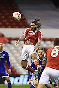 Nottingham Forest midfielder Henri Lansbury (10) wins the ball in the air during the EFL Sky Bet Championship match between Nottingham Forest and Cardiff City at the City Ground, Nottingham, England on 22 October 2016. Photo by Jon Hobley.