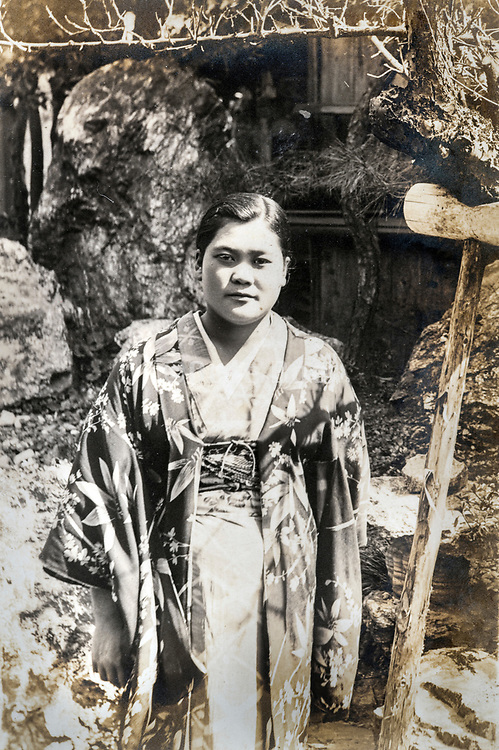 young adult woman in traditional kimono clothing casual posing outdoors portrait ca 1930s Japan