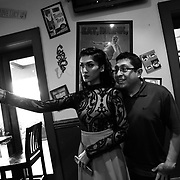 Ariel Zavala, left, takes a selfie with her father Art after dinner at Hamburger Mary's Saturday, Saturday, April 30, 2016 in Clearwater. Zavala who is transitioning from male to female attended her prom for Alonso High School on Saturday. CHRIS URSO/STAFF