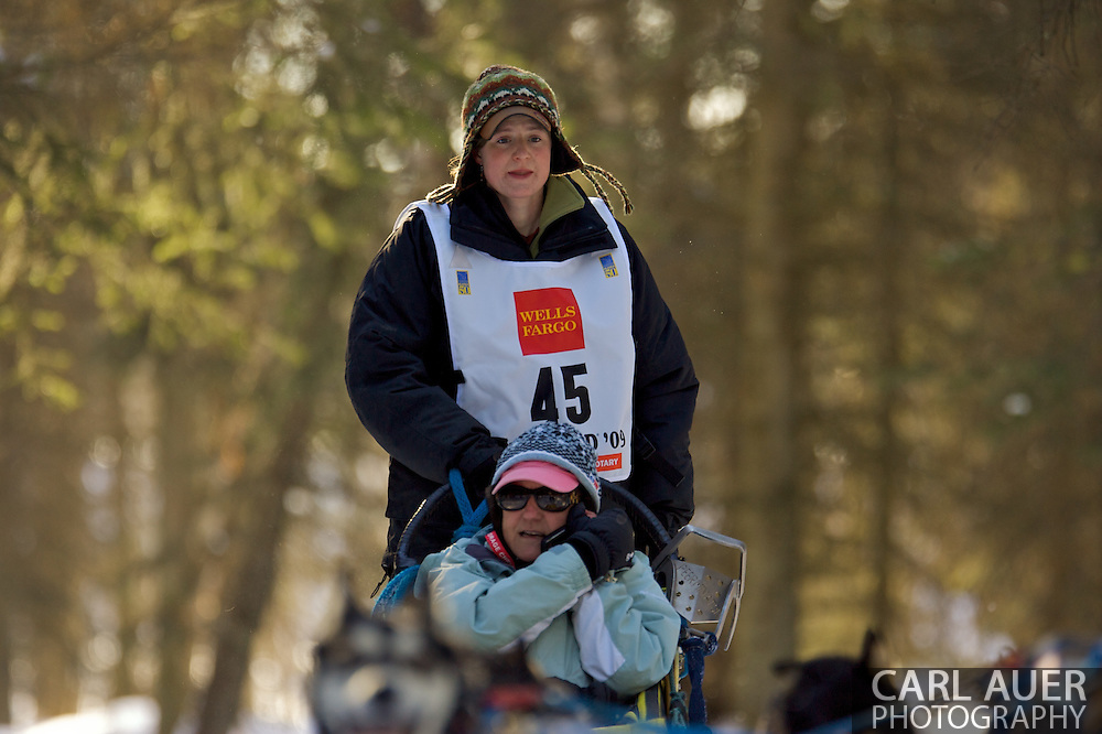 March 7th, 2009:  Anchorage, Alaska - Laura Daugereau of Port Gamble, Washington moves through the Behm Lake woods during the 2009 Iditarod.
