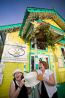 """These two funny ladies give new meaning to the expression """"Being in your cups"""" at the Twisted Sisters tearoom restaurant in the picturesque town of Chemanius.  Vancouver Island, British Columbia, Canada."""
