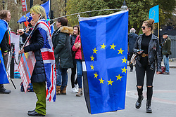 © Licensed to London News Pictures. 27/03/2019. London, UK. Anti-Brexit demonstrators protest with an EU flag outside the Houses of Parliament. Later today the MPs will votes on series of indicative votes on alternatives to Prime Minister Theresa May's Brexit deal. Photo credit: Dinendra Haria/LNP