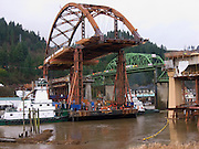 Raplacement Sauvie Island Bridge being floated down the Willamette River and guided into position after fabrication in Portland.   Contractor: Max J. Kuney Co.; Owner: Oregon DOT (ODOT).