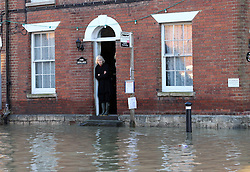 Boxing Day floods.. A resident  looks out from the front door of her  home in Yalding, Kent  as villagers   brace themselves for the possibility of more flooding with another storm on the way, Thursday, 26th December 2013. Picture by Stephen Lock / i-Images