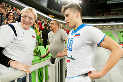 Klemen Cebulj #18 of Slovenia with mom during qualifications match for FIVB Men's World Championship 2014 between National team Slovenia and Israel in pool B on May 24, 2013 in SRC Stozice, Ljubljana, Slovenia. (Photo By Urban Urbanc / Sportida)
