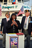 Freeport, New York, USA. 10th Sept. 2014. Town of Hempstead Councilwoman DOROTHY GOOSBY speaks at a dockside remembrance ceremony in honor of victims of the terrorist attacks of September 11 2001, at the boat Miss Freeport V, on Freeport's Nautical Mile. Further ceremonies were held on board the vessel, which sailed from the Woodcleft Canal on the South Shore of Long Island, on the eve of the 13th Anniversary of the 9/11 attacks.