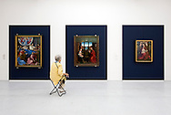 Visitors view paintings by the Flemish masters at the Groeninge Museum in Bruges, Belgium. (Photo © Jock Fistick)