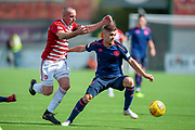 Darian Mackinnon of Hamilton Academical FC challenges Benjamin Garuccio of Heart of Midlothian during the Ladbrokes Scottish Premiership League match between Hamilton Academical FC and Heart of Midlothian FC at New Douglas Park, Hamilton, Scotland on 4 August 2018. Picture by Malcolm Mackenzie.